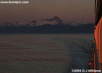 sunrise over snow capped alaska mountains